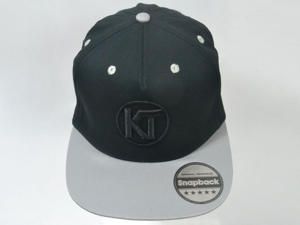 41c8dd08f61c6 Official Team KT Snapback Cap - Grey Black with Black Logo - Katie ...